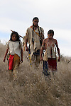 Three young Native American Indian boys walking down a hill in South Dakota