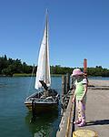 Child and Sailboat in Turku Archipelago, Finland
