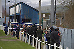 Glossop North End 0 Barnoldswick Town 1, 19/02/2011. Surrey Street, North West Counties League Premier Division. Glossop North End supporters watching the action as their club play Barnoldswick Town in the Vodkat North West Counties League premier division at the Surrey Street ground. The visitors won the match by one goal to nil watched by a crowd of 203 spectators. Glossop North End celebrated their 125th anniversary in 2011 and were once members of the Football League in England, spending one season in the top division in 1899-00. Photo by Colin McPherson.