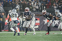FOXBOROUGH, MA - NOVEMBER 24: Dallas Cowboys Safety Xavier Woods #25 prepares to tackle New England Patriots Runningback Sony Michel #26 during a game between Dallas Cowboys and New England Patriots at Gillettes on November 24, 2019 in Foxborough, Massachusetts.
