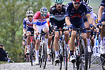 The peloton including Daniel Oss (ITA) Bora-Hansgrohe and Dutch Champion Mathieu Van Der Poel (NED) Alpecin-Fenix on the first ascent of the Paterberg during the Tour of Flanders 2020 running 244km from Antwerp to Oudenaarde, Belgium. 18th October 2020. <br /> Picture: Bora-Hansgrohe/Nico Vereecken/PN/BettiniPhoto   Cyclefile<br /> <br /> All photos usage must carry mandatory copyright credit (© Cyclefile   Bora-Hansgrohe/Nico Vereecken/PN/BettiniPhoto)