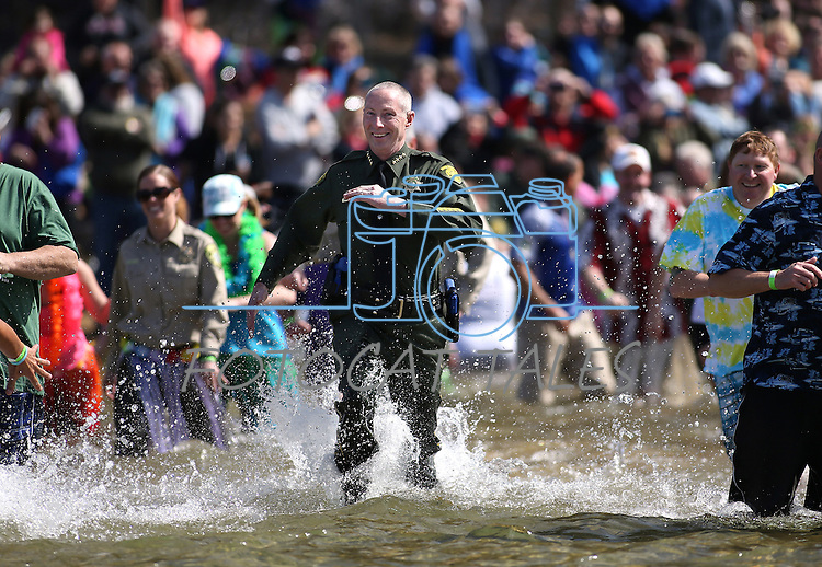 Washoe County Sheriff Chuck Allen joins hundreds of plungers in the South Lake Tahoe Polar Plunge at Zephyr Cove, Nev., on Saturday, March 21, 2015. <br /> Photo by Cathleen Allison