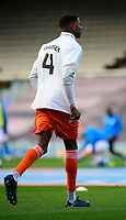 Blackpool's Marvin Ekpiteta during the pre-match warm-up wearing a t-shirt in tribute to Warren Green, Blackpool's academy manager, who died aged 46<br /> <br /> Photographer Chris Vaughan/CameraSport<br /> <br /> The EFL Sky Bet League One - Peterborough United v Blackpool - Saturday 21st November 2020 - London Road Stadium - Peterborough<br /> <br /> World Copyright © 2020 CameraSport. All rights reserved. 43 Linden Ave. Countesthorpe. Leicester. England. LE8 5PG - Tel: +44 (0) 116 277 4147 - admin@camerasport.com - www.camerasport.com