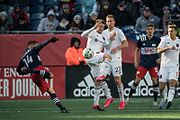 FOXBOROUGH, MA - MARCH 7: Diego Fagundez #14 of New England Revolution readies to kick a high ball as Djordje Mihailovic #14 of Chicago Fire jumps to intercept during a game between Chicago Fire and New England Revolution at Gillette Stadium on March 7, 2020 in Foxborough, Massachusetts.