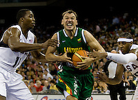 US center (11) Dwight Howard and forward (15) Carmelo Anthony fouls Lithuania guard (13) Sarunas Jasikevicius as he moves into the lane while playing at the Cotai Arena inside the Venetian Macau Resort and Hotel.  The US defeated Lithuania, 120-84.