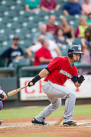 Oklahoma City RedHawks second baseman Joe Sclafani (22) follows through on his swing during the Pacific Coast League baseball game against the Round Rock Express on August 1, 2014 at the Dell Diamond in Round Rock, Texas. The Express defeated the RedHawks 6-5. (Andrew Woolley/Four Seam Images)