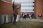 Blackburn Rovers 2 Aston Villa 0, 21/11/2010. Ewood Park, Premier League. Fans walking past a statue of former owner Jack Walker outside Ewood Park, home of Blackburn Rovers, before the club played host to Aston Villa in a Barclays Premier League match. Blackburn won the match by two goals to nil watched by a crowd of 21,848. It was Rovers' first match under the ownership of Indian company Venky's. Photo by Colin McPherson.