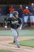 John Schuknecht (48) of the Cal Poly Mustangs runs to first base during a game against the Cal State Fullerton Titans at Goodwin Field on April 2, 2015 in Fullerton, California. Cal Poly defeated Cal State Fullerton, 5-0. (Larry Goren/Four Seam Images)