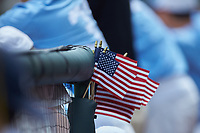 A bunch of American Flags on display in the North Carolina Tar Heels dugout during the game against the Florida State Seminoles in the 2017 ACC Baseball Championship Game at Louisville Slugger Field on May 28, 2017 in Louisville, Kentucky. The Seminoles defeated the Tar Heels 7-3. (Brian Westerholt/Four Seam Images)