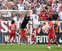 Clint Dempsey (8) of the USMNT has the ball punched away from him by Volkan Demirel (1) of Turkey at Lincoln Financial Field in Philadelphia, PA.  The USMNT defeated Turkey, 2-1.