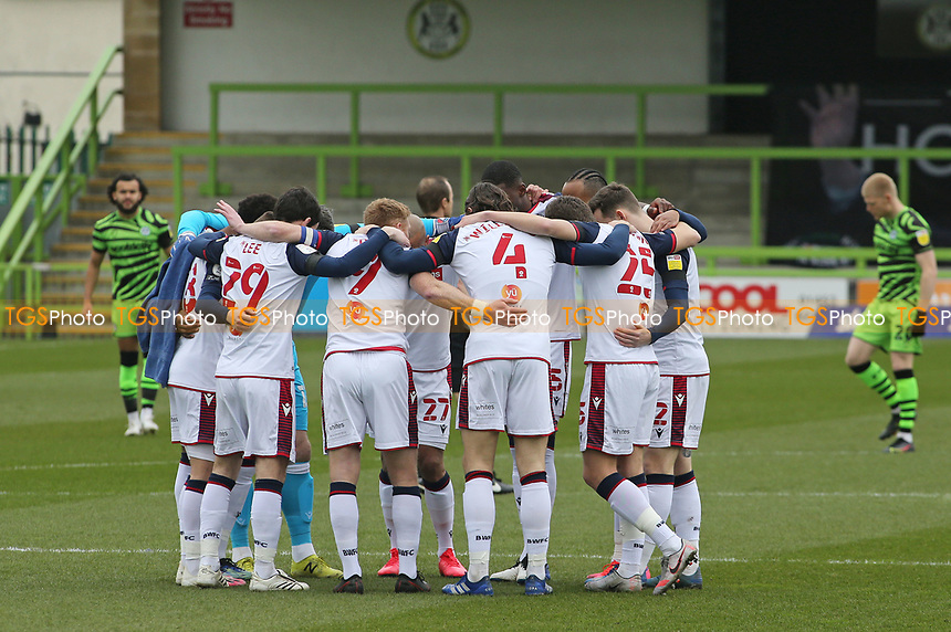 Bolton huddle during Forest Green Rovers vs Bolton Wanderers, Sky Bet EFL League 2 Football at The New Lawn on 27th March 2021