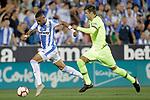 CD Leganes' Youssef En-Nesyri (l) and FC Barcelona's Gerard Pique during La Liga match. September 26,2018. (ALTERPHOTOS/Acero)