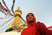 Buddhist Monk pilgrim at the Boudhanath stupa Kathmandu also known as little Tibet, Nepal