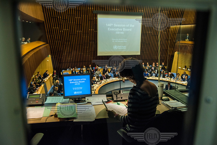 Transaltor in a booth at the opening session of the Executive Board Meeting of the World Health Organisation, the UN's health body, at the organisation's headquarters in Geneva. The annual event is taking place in the shadow of the Corona virus outbreak, which the WHO has declared as global health emergency.