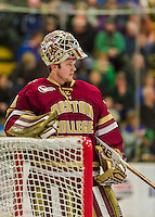 20 February 2016: Boston College Eagle Goaltender Thatcher Demko, a Junior from San Diego, CA, takes a moment after a stop in play during the second period against the University of Vermont Catamounts at Gutterson Fieldhouse in Burlington, Vermont. The Eagles defeated the Catamounts 4-1 in the second game of their weekend series. Mandatory Credit: Ed Wolfstein Photo *** RAW (NEF) Image File Available ***