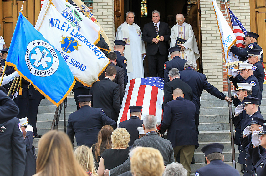 The casket containing the remains of longtime firefighter EMT Dan McCann is carried into St. Cecilia's Church in Kearny for his funeral mass. McCann, a firefighter EMT with more than 25 years experience, died last week after a fire department training exercise in Manasquan.  9/21/16  (Andrew Mills   NJ Advance Media for NJ.com)