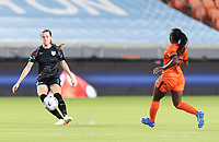 HOUSTON, TX - SEPTEMBER 10: Tierna Davidson #26 of the Chicago Red Stars passes the ball in front of Nichelle Prince #8 of the Houston Dash during a game between Chicago Red Stars and Houston Dash at BBVA Stadium on September 10, 2021 in Houston, Texas.