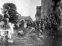 Members of the 101st Field Signal Battalion (formerly 1st Massachusetts F.S.B.) at outdoor church services in the ruins of a church destroyed by shell fire.  Verdun, France.  October 18, 1918.  Cpl. A. Klein. (Army)<br /> NARA FILE #:  111-SC-27518<br /> WAR & CONFLICT BOOK #:  652