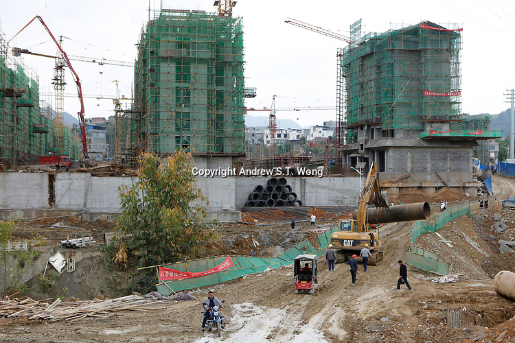New units of government housing are being built to relocate poor families of the ethnic Bouyei Tribe from rural areas at Wangmo County in China's southwestern Guizhou Province, April 2019.