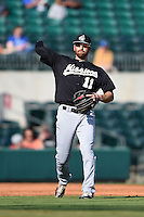 San Antonio Missions third baseman Adam Buschini (11) throws to first during a game against the Arkansas Travelers on May 25, 2014 at Dickey-Stephens Park in Little Rock, Arkansas.  Arkansas defeated San Antonio 3-1.  (Mike Janes/Four Seam Images)