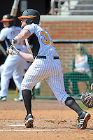 Josh Liles #33 of the Tennessee Volunteers squares for a bunt at Lindsey Nelson Stadium against the the Manhattan Jaspers on March 12, 2011 in Knoxville, Tennessee.  Tennessee won the first game of the double header 11-5.  Photo by Tony Farlow / Four Seam Images..