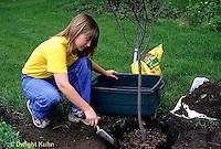TT19-059z  Girl filling hole, planting tree - (TT19-004e,047z,048z,050z,051z,053z,056z,059z)