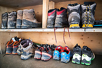 The Chamonix to Zermatt Glacier Haute Route. In late August 2017, we ran the tour in mountain running gear, running shoes, and all the necessary glacier travel and crevasse rescue gear. Inside the Bertol Hut, our running shoes sit in contrast to all the boots.