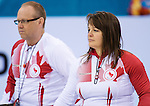 Sochi, RUSSIA - Mar 13 2014 - Ina Forrest, and Dennis Thiessen as Canada takes on Slovakia in round robin play at the 2014 Paralympic Winter Games in Sochi, Russia.  (Photo: Matthew Murnaghan/Canadian Paralympic Committee)