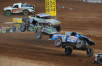 Mar. 20, 2011; Chandler, AZ, USA;  LOORRS pro two driver Robby Woods (99) leads Marty Hart (15) and Greg Adler during round two at Firebird International Raceway. Mandatory Credit: Mark J. Rebilas-