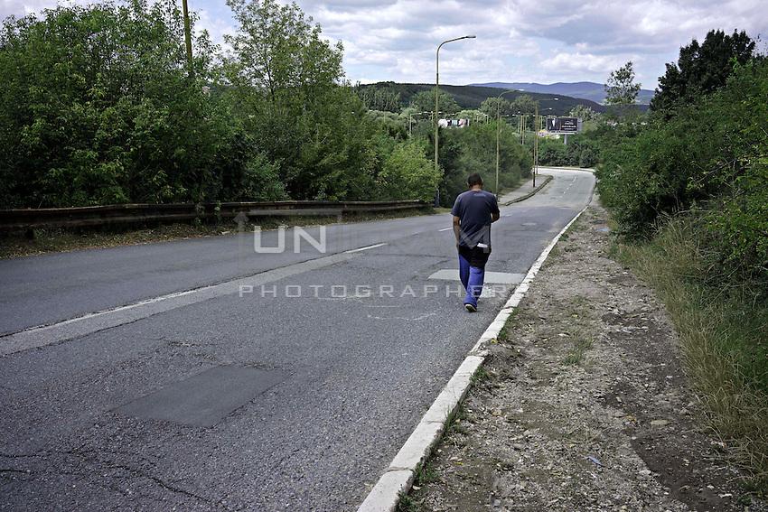 A roma man walking home to Lunik IX.