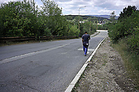 A roma man walking home to Lunik IX.