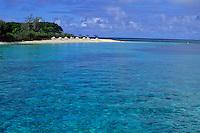 Crystal blue waters and white sand beach on Amedee Island, Noumea Lagoon, New Caledonia.