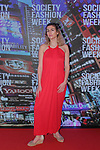 Model poses on red carpet in an outfit from The Red Umbrella collection fashion show, at The Society Fashion Week on September 9, 2018 at The Roosevelt Hotel in New York City, during New York Fashion Week Spring Summer 2019.