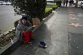 Los Angeles, California<br /> January 30, 2014<br /> <br /> Benjamin Samual (cq) Wahl, 28, from Philadelphia who served two years of a four-year signup with the Navy now stays in the PATH shelter after a few years on the streets. He and his wife Brandi Wahl, 24 are applying for HUD Vash housing vouchers. He panhandles on the streets of Hollywood during the day.