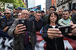 """© Joel Goodman - 07973 332324 . 11/06/2017 . Manchester , UK . People pose for selfies with TOMMY ROBINSON . Demonstration against Islamic hate , organised by former EDL leader Tommy Robinson's """" UK Against Hate """" and opposed by a counter demonstration of anti-fascist groups . UK Against Hate say their silent march from Piccadilly Train Station to a rally in Piccadilly Gardens in central Manchester is in response to a terrorist attack at an Ariana Grande concert in Manchester , and is on the anniversary of the gun massacre at the Pulse nightclub in Orlando . Photo credit : Joel Goodman"""