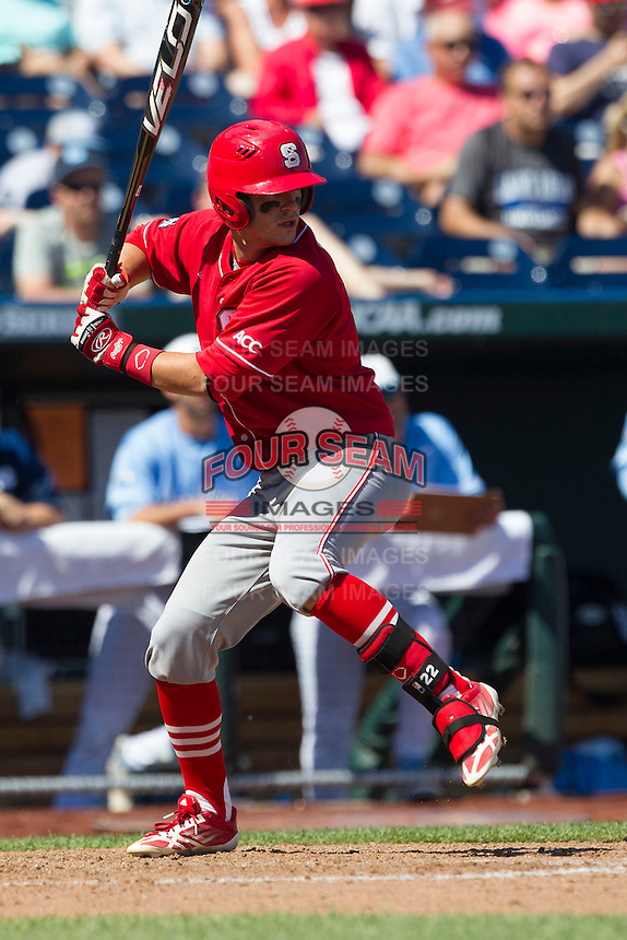 North Carolina State third baseman Grant Clyde (22) at bat during Game 3 of the 2013 Men's College World Series between the North Carolina State Wolfpack and North Carolina Tar Heels at TD Ameritrade Park on June 16, 2013 in Omaha, Nebraska. The Wolfpack defeated the Tar Heels 8-1. (Andrew Woolley/Four Seam Images)