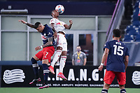 FOXBOROUGH, MA - MAY 22: Gustavo Bou #7 of New England Revolution and Kyle Duncan #6 of New York Red Bulls compete for a high ball during a game between New York Red Bulls and New England Revolution at Gillette Stadium on May 22, 2021 in Foxborough, Massachusetts.