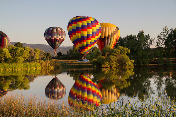 Getty Images exclusive, Hot air balloon and reflection in lake, Boulder, Colorado, USA.