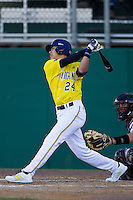 Michigan Wolverines second baseman Hector Gutierrez (24) follows through on his swing during the NCAA season opening baseball game against the Texas State Bobcats on February 14, 2014 at Bobcat Ballpark in San Marcos, Texas. Texas State defeated Michigan 8-7 in 10 innings. (Andrew Woolley/Four Seam Images)