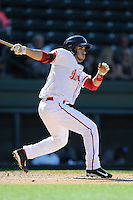 Left fielder Carlos Asuaje (20) of the Greenville Drive bats in a game against the Asheville Tourists on Wednesday, April 23, 2014, at Fluor Field at the West End in Greenville, South Carolina. Greenville won, 6-0. (Tom Priddy/Four Seam Images)