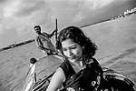 A girl takes a joy ride on a boat at the river Ganga in Kolkata, India.