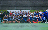 The teams pose for a group photo after the Auckland Blue v North Harbour 1 final, which was abandoned after the third quarter due to extreme weather conditions. Under-18 Hockey Tournament finals day at National Hockey Stadium in Wellington, New Zealand on Saturday, 17 July 2021. Photo: Dave Lintott / lintottphoto.co.nz https://bwmedia.photoshelter.com/gallery-collection/Under-18-Hockey-Nationals-2021/C0000T49v1kln8qk