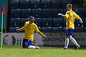 Cowdenbeath's Kane Hemmings (21) celebrates with Kenny Adamson (3) after he scores their first goal.