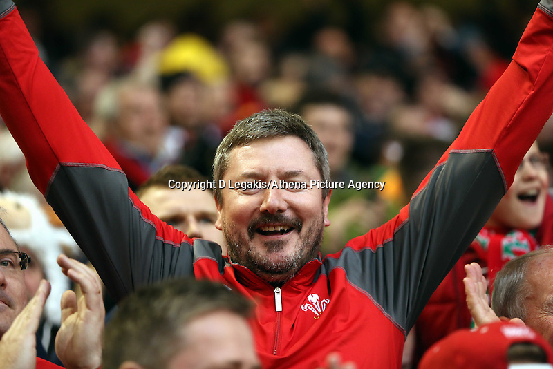 Pictured: A Wales supporter celebrates his team's win Saturday 14 March 2015<br /> Re: RBS Six Nations, Wales v Ireland at the Millennium Stadium, Cardiff, south Wales, UK.