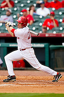 Caleb Ramsey #28 of the Houston Cougars follows through on his swing against the Baylor Bears at Minute Maid Park on March 4, 2011 in Houston, Texas.  Photo by Brian Westerholt / Four Seam Images
