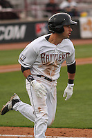 Wisconsin Timber Rattlers catcher Carlos Leal (11) rounds first base during a game against the Cedar Rapids Kernels on May 4th, 2015 at Fox Cities Stadium in Appleton, Wisconsin.  Cedar Rapids defeated Wisconsin 9-3.  (Brad Krause/Four Seam Images)