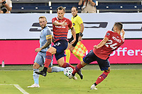 KANSAS CITY, KS - SEPTEMBER 02: Reto Ziegler #3 of FC Dallas and Matt Hedges #24 of FC Dallas look at clearing the ball during a game between FC Dallas and Sporting Kansas City at Children's Mercy Park on September 02, 2020 in Kansas City, Kansas.