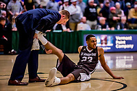 18 December 2018: St. Bonaventure University Bonnies Guard Jalen Poyser, a Junior from Malton, Ontario, has a leg cramp tended to during the second overtime period against the University of Vermont Catamounts at Patrick Gymnasium in Burlington, Vermont. The Catamounts defeated the Bonnies 83-76 in a double-overtime NCAA DI game. Mandatory Credit: Ed Wolfstein Photo *** RAW (NEF) Image File Available ***