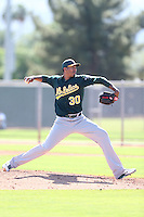 Michael Ynoa #30 of the Oakland Athletics pitches during a Minor League Spring Training Game against the Los Angeles Angels at the Los Angeles Angels Spring Training Complex on March 17, 2014 in Tempe, Arizona. (Larry Goren/Four Seam Images)
