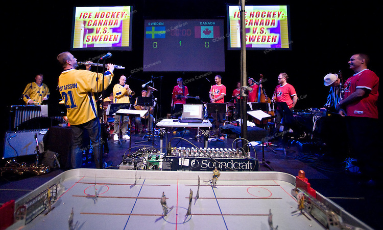 Canadian clarinettist François Houle and Swedish saxophonist Mats Gustafsson, composed a number of pieces based on the rules, systems and culture of ice hockey for an ensemble of 14 artists.
